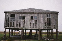 an old abandoned house on stilts