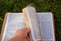 turning pages of a Bible
