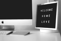 home office with a welcome home sign