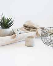 house plant, potted plant, wire basket, basket, linen, fabric, wood, tray, votive, candle, white background