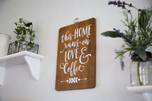 this home runs on love and coffee sign