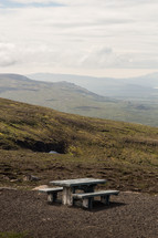 picnic table on a mountaintop