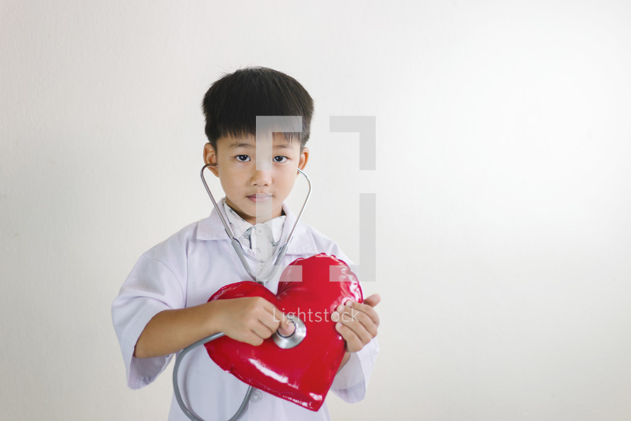 boy with stethoscope and heart