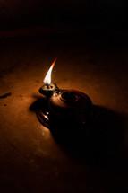 a flame in a clay lantern