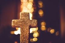 stone cross and bokeh lights