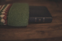 A Bible sticking out of a stocking on wood