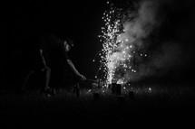 man lighting fireworks