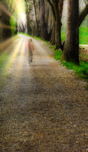 child running down a dirt road