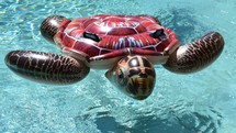 Pool party, sea turtle float in a swimming pool