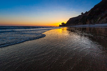 Wet sand on a beach shore, El Matador Beach, southern California