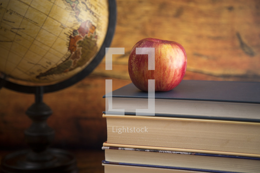 Education Background with a Stack of Books and an Apple