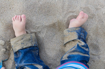 toddler's feet in the sand