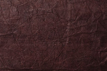 maroon textured paper background.
