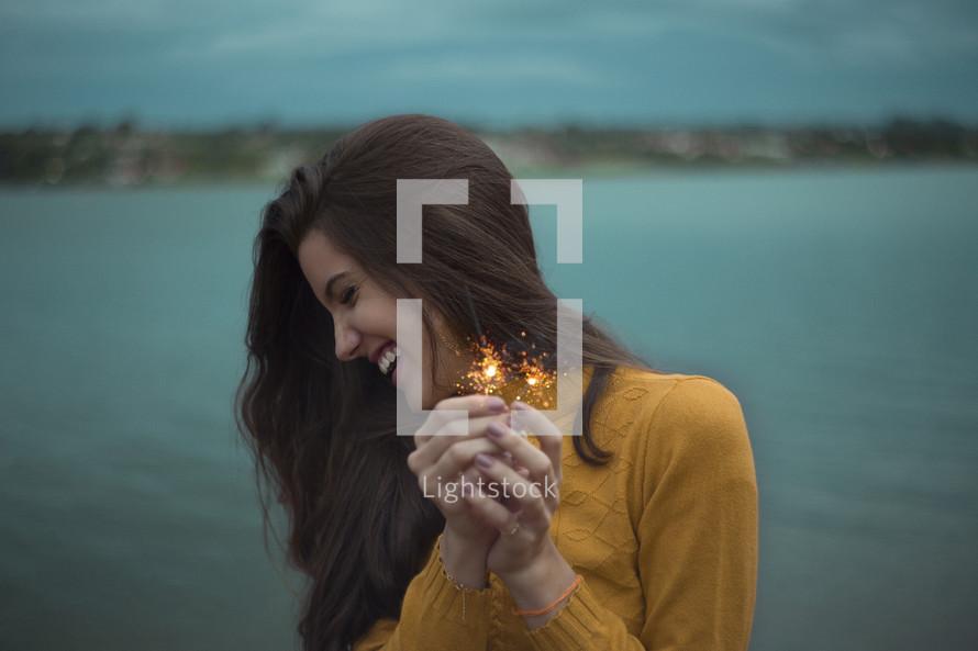 teen girl holding sparklers