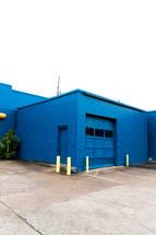 blue brick building and garage door