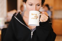 woman drinking out of a coffee mug, Best day ever