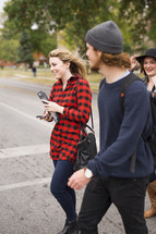 students walking to class on a college campus