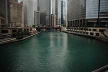 A river between tall buildings.