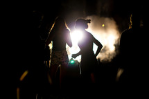 silhouettes of teen girls at night