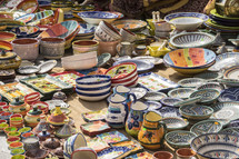 colorful bowls and porcelain pitchers at a market