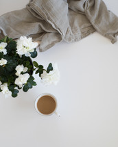 white flowers, linen fabric, coffee cup