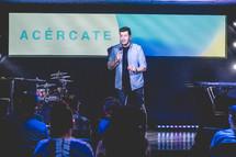 worship leader speaking on stage