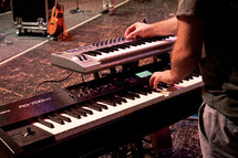 Man playing a keyboard.