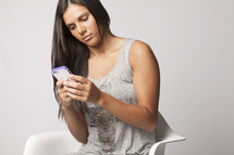 woman looking at her cellphone