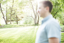 blurry image of a man standing outdoors