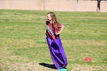 a child in a sack race
