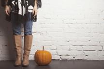 woman and a pumpkin