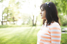 side profile of a woman standing outdoors