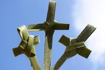 three palm crosses against the sky for Palm Sunday or Easter