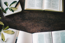 open Bibles and notebooks on a wood background for a Bible study