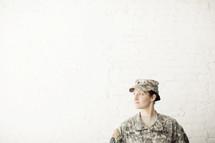 Female soldier looking away.