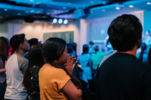 praying during a worship service