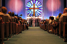 standing at the altar at a church during a worship service