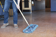 janitor mopping a floor
