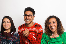 friends in ugly Christmas sweaters