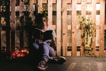 a teen girl sitting quietly and reading