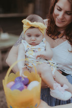 an aunt holding her infant niece and an Easter basket