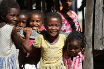 young girl orphans smiling and giggling