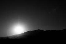 sunburst over mountains