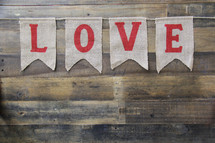 love banner against a wooden background