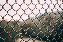 chain link fence and river river
