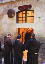 monks praying in Jerusalem
