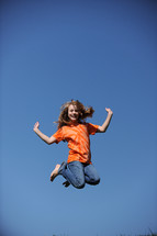 girl child jumping in the air