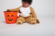 a toddler boy in a Halloween costume