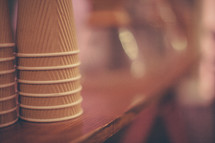 stacked paper coffee cups