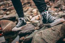 sneakers standing on rocks
